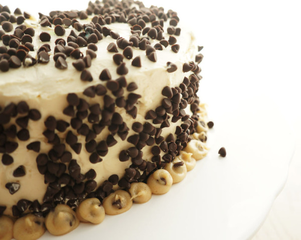 Vanilla cake filled with cookie dough covered in chocolate chips